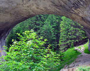 natural phenomenon of an arch in the mountain