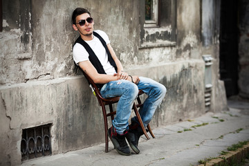Attractive young man relaxing in urban background