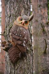 Toy- owl on te pine tree