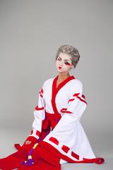 Beautiful young woman in white kimono