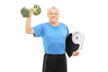 Senior lifting a broccoli dumbbell