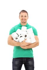 Young guy holding a bunch of toilet paper rolls