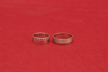 Two Rings on the Red Background