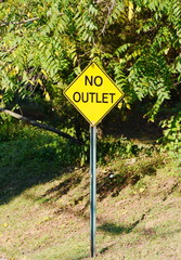A yellow no outlet sign