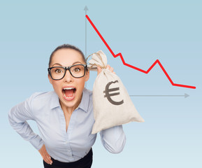 businesswoman holding money bag with euro
