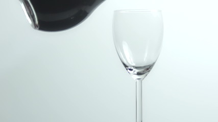 Pouring red wine