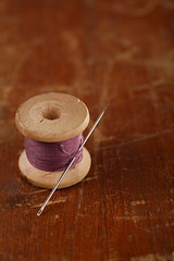 real old reels spoon treads with needle and thimble on old woode