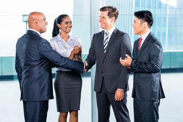 Business team having agreement and handshake