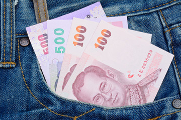 thai banknotes in jeans pocket for money and business concept