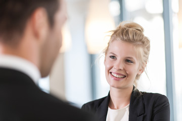 businesswoman talking with a man
