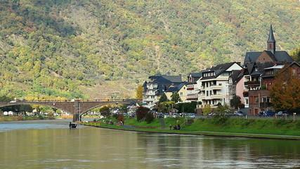 Village quay, river bridge neat town house buildings green hills