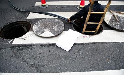 working in a open manhole