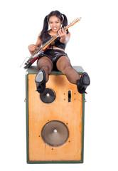 rock musician doing sit at loud-speaker