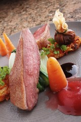 pan fried duck breast plated meal