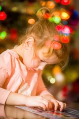 Little child solving a puzzle