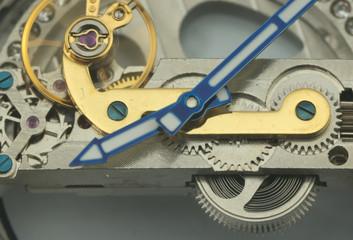 clock mechanic inside, clockwork close up.