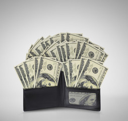 dollars in bills spilling out of billfold