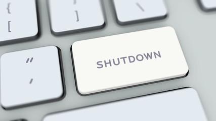 Shutdown button on computer keyboard. Key is pressed