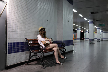 Teen on the bench in subway station