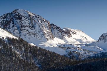 snow mountain peak with sunlight, colorado