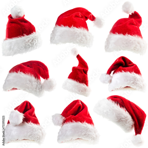 Leinwandbild Motiv Set of red Santa Claus hats