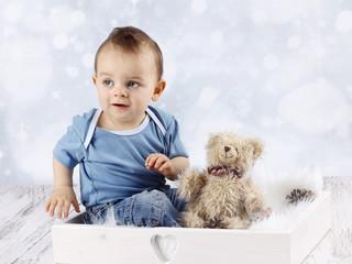 Little baby boy with plush teddy bear