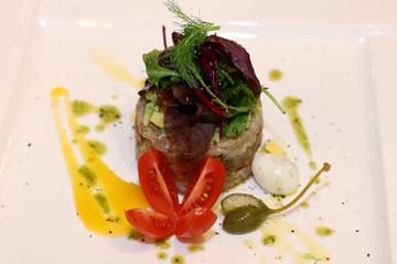 Tri salmon tartar with green salad