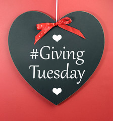 Giving Tuesday message greeting on heart blackboard