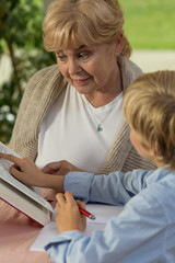 Granny and grandchild reading book