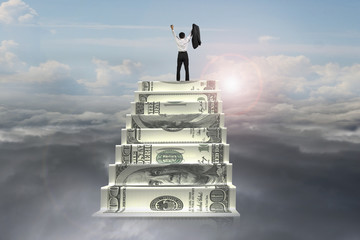 businessman cheer on top of money stairs with sunlight cloudscap