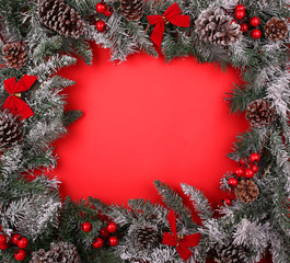 Christmas decorative border with pine cones and holly berries
