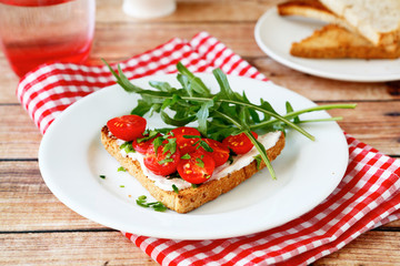 Bruschetta with tomatoes and arugula