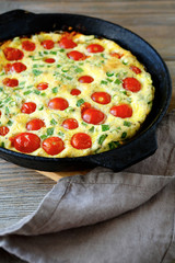 Delicious frittata in a frying pan