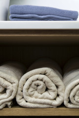Towels in wooden storage close up