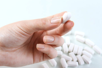 Pills in hand, close-up
