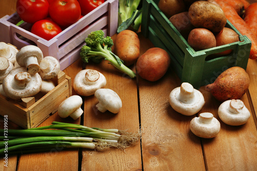 canvas print picture Different vegetables in boxes on wooden background top view