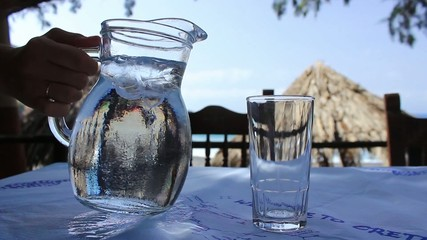 Glass of water and pitcher