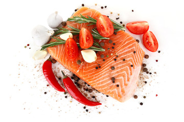 Fresh salmon with spices isolated on white