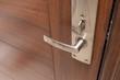 metal door handle on wooden door - 73399849