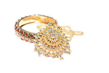 Close up of diamond necklace and bracelet on  white background