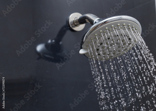 shower head with water drops flowing - 73399874