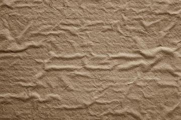 rough texture old crumpled paper of sepia color