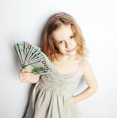 a little girl with a fan dolar