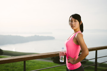 Pensive fitness woman looking the ocean