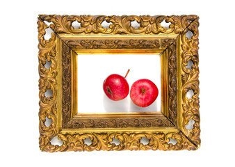 two red apple in ancient antique golden picture frame