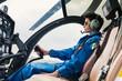 Leinwanddruck Bild - Young woman helicopter pilot.