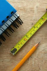 Notebook, tape measure and a pencil