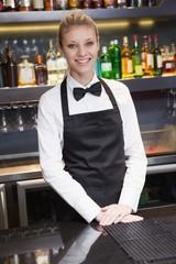 Pretty waitress smiling at the camera