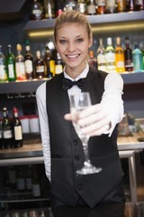 Pretty woman offering flute of champagne