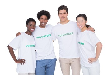 Young smiling volunteers looking at camera